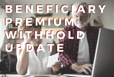 Image of older adults reviewing bills and on computer Beneficiary Premium Withhold Update from CMS
